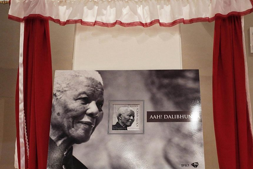 The South African Post Office newly released Nelson Mandela commemorative stamp is presented at the Nelson Mandela Foundation in Johannesburg on Feb 11, 2014.South Africa issued a black-and-white commemorative stamp on Tuesday to celebrate the