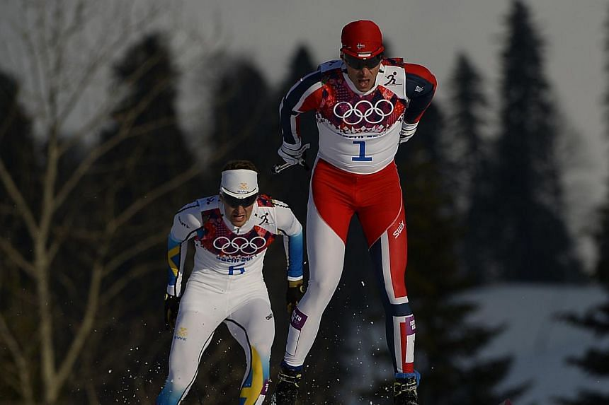 Norway's Ola Vigen Hattestad (right) competes in front of Sweden's Teodor Peterson to win the Men's Cross-Country Skiing Individual Sprint Free Final at the Laura Cross-Country Ski and Biathlon Center during the Sochi Winter Olympics on Feb 11, 2014,