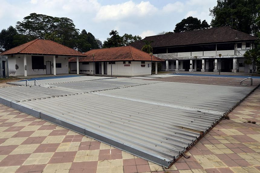 View of the disused swimming pool at one of the old black and white bungalows located at Park Lane inside Seletar Aerospace Park. -- ST PHOTO: DESMOND FOO