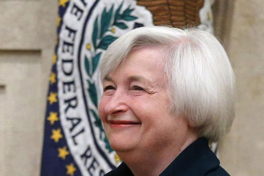 New Federal Reserve Board Chairwoman Janet Yellen smiles as she arrives to take the oath of office at the Federal Reserve Board in Washington, on Feb3, 2014. New Federal Reserve chair Janet Yellen said on Monday, Feb 11, 2014, that she had no plans t