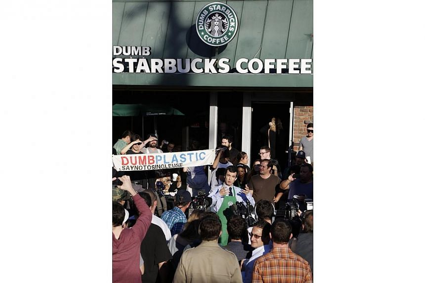 """Nathan Fielder, host of the Comedy Central show """"Nathan For You,"""" steps forward as being behind the Dumb Starbucks store in the Los Feliz neighbourhood, on Feb 10, 2014 in Los Angeles California. -- PHOTO: AFP"""