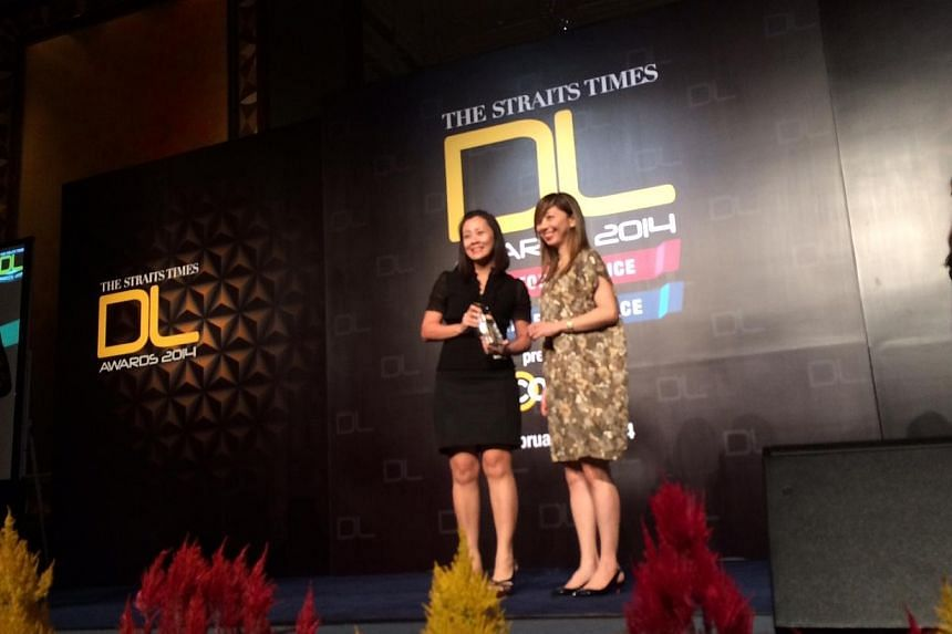 Straits Times associate editor Sumiko Tan presents the best digital advertising (tablet) award which went to electronics company Panasonic Singapore. -- ST PHOTO: DERRICK HO