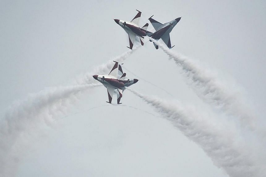 The RSAF Black Knights perform at the Singapore Airshow 2014 on February 11. -- ST PHOTO: MUGILAN RAJASEGERAN
