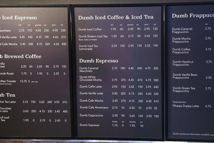 """A menu board is pictured at """"Dumb Starbucks"""", a parody store of the Starbucks Coffee chain, in Los Angeles, California, on Feb 10, 2014. -- PHOTO: REUTERS"""