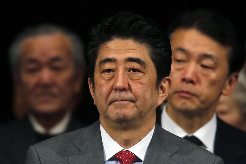 Japan's Prime Minister Shinzo Abe (centre) attends a Northern Territories Day rally in Tokyo, on Feb 7, 2014.A Chinese Communist Party mouthpiece on Tuesday criticised Japanese Prime Minister Shinzo Abe in unusually harsh terms, denouncing the