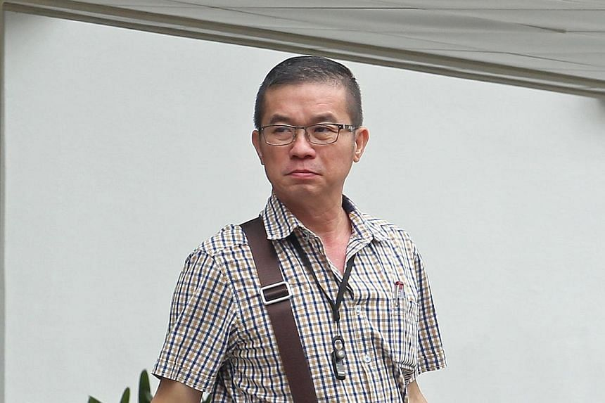 Goh Choon Hee, 50, is seen leaving the Subordinate Court on Tuesday, Feb 11, 2014. Goh admitted to offering an SCDF fire-fighter a $1,000 bribe not to report him for a traffic offence. -- ST PHOTO:SEAH KWANG PENG