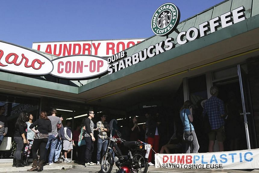 The line outside Dumb Starbucks stretches half way around the block with customers waiting roughly 2.5 hours for a free coffee in the Los Feliz neighbourhood, on Monday, Feb 10, 2014, in Los Angeles, California. US health officials closed down a spoo