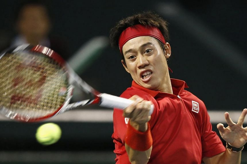 Japan's Kei Nishikori returns a shot against Canada's Frank Dancevic during their Davis Cup world group first round tennis match in Tokyo, on Feb 2, 2014.Australia's Lleyton Hewitt on Tuesday said Kei Nishikori was developing into a serious con