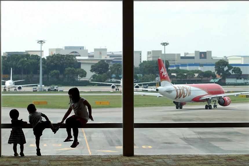Three children at the viewing gallery of the revamped Terminal 1 of Changi Airport.Economic links are strong between ASEAN member states and the European Union, but direct air links between the two regions have not grown as quickly. -- ST FILE