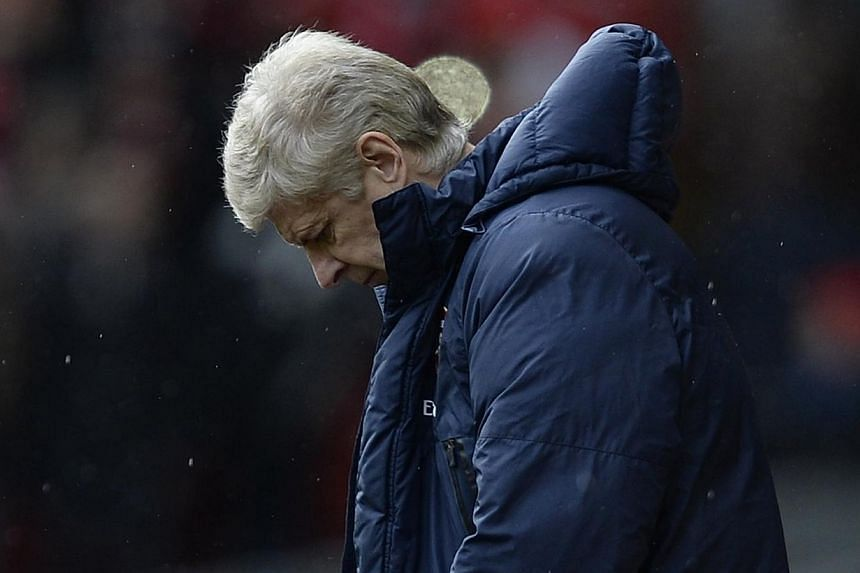 """Arsenal's manager Arsene Wenger reacts during their English Premier League soccer match against Liverpool at Anfield Stadium in Liverpool, northern England, on Feb 8, 2014. Wenger has described his side's 5-1 thrashing at Liverpool as an """"accident"""" a"""