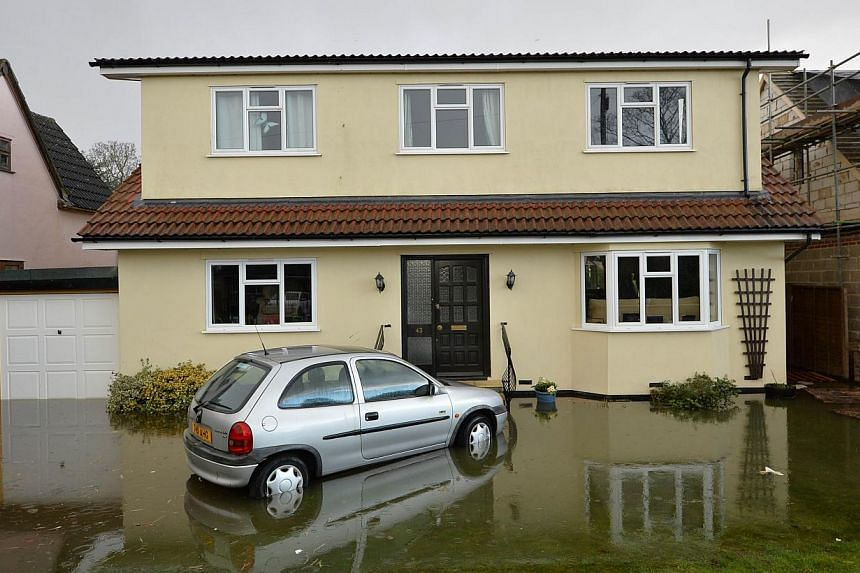 A picture shows flood water surrounding a home in the village of Wraysbury in Berkshire, south-east England, on Feb 10, 2014. -- FILE PHOTO: AFP