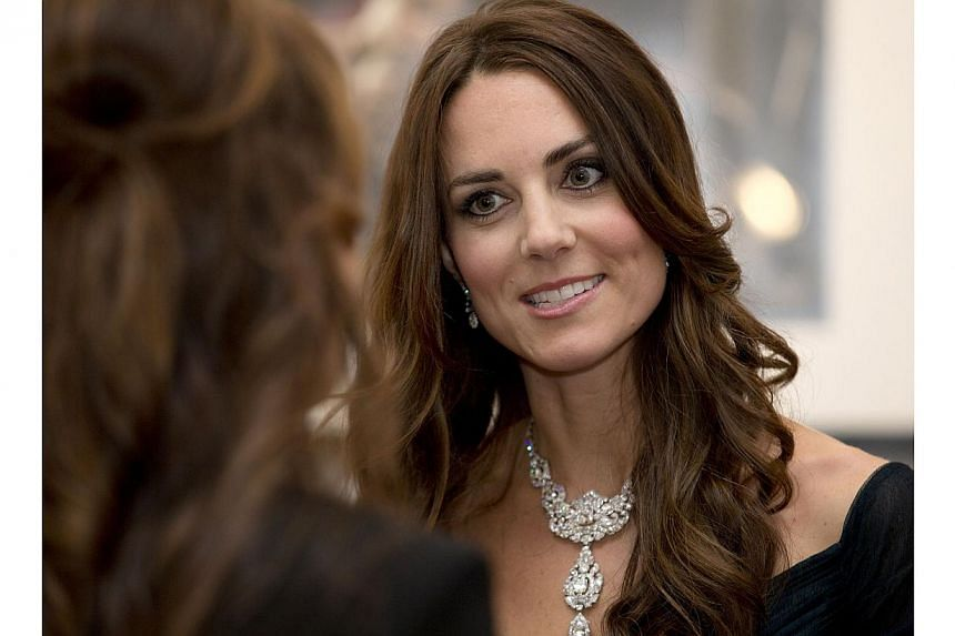 Britain's Catherine, Duchess of Cambridge talks with a guest during the Portrait Gala 2014 at the National Portrait Gallery in central London, on Feb 11, 2014. -- PHOTO: AFP