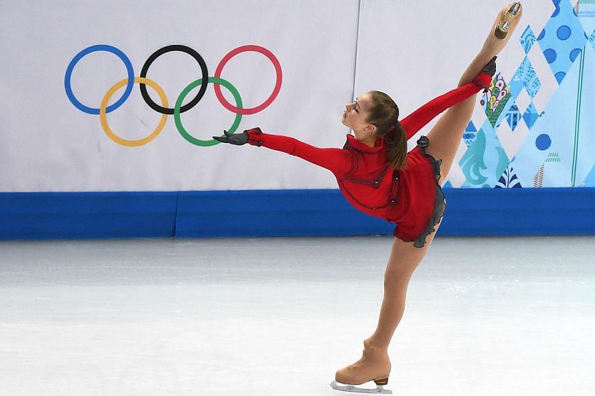 Russia's Julia Lipnitskaia performs in the Women's Figure Skating Team Free Program at the Iceberg Skating Palace during the Sochi Winter Olympics on Feb 9, 2014. -- PHOTO:AFP