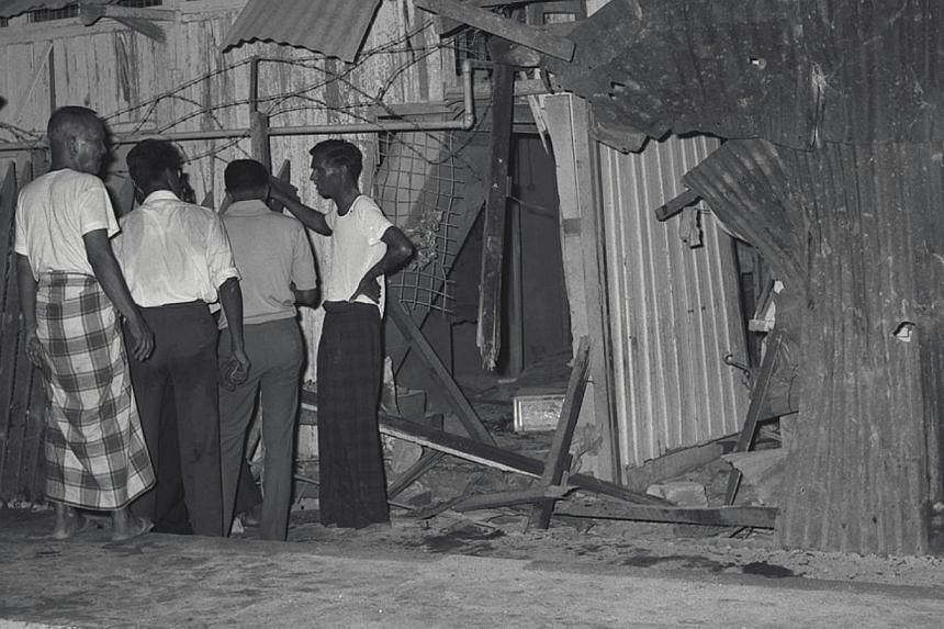 A mother and her daughter were killed and six others injured when a bomb exploded in Jalan Rebong on April 13, 1964. Three days later, another bomb went off about a kilometre away. -- ST FILE PHOTO