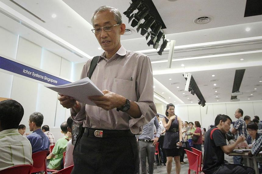 The labour movement has called on the Government to raise the Central Provident Fund contributions of older workers in the upcoming Budget. -- ST FILE PHOTO: JASON QUAH