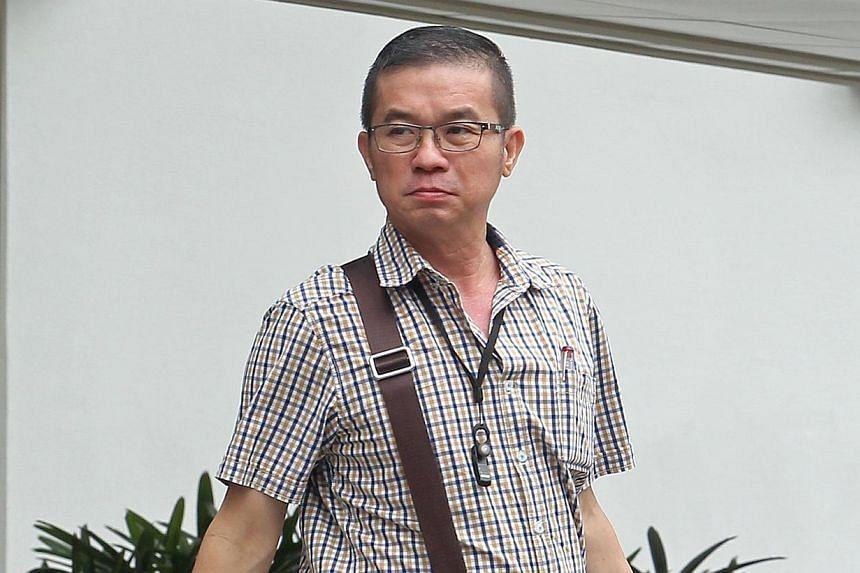 Goh Choon Hee leaving the Subordinate Court on Feb 11, 2014. -- ST PHOTO: SEAH KWANG PENG