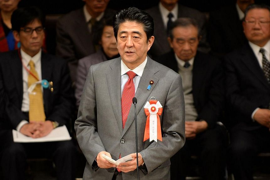 Japanese PM Shinzo Abe (centre) delivers a speech calling for the return of the Russia-controlled Southern Kurils, which Japan claims as the Northern Territories, in Tokyo on Feb 7, 2014. -- FILE PHOTO: AFP