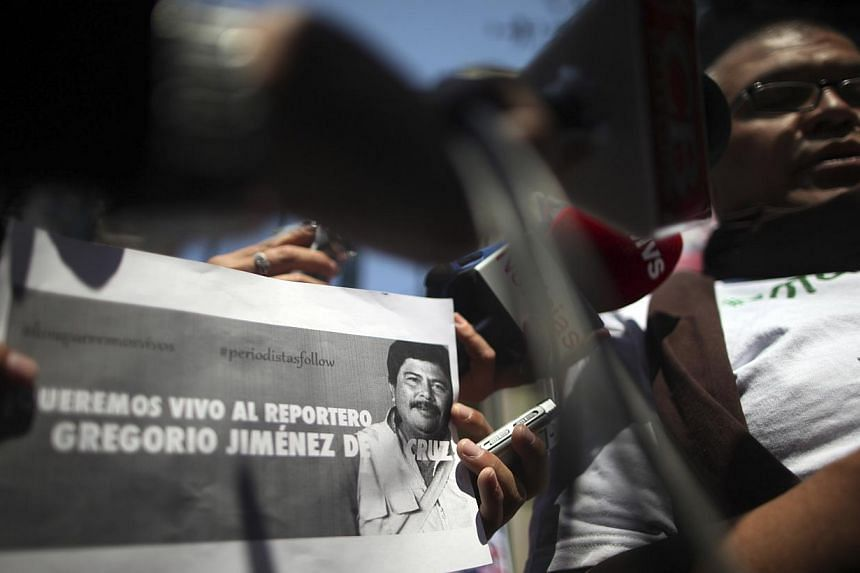 Journalists speak during a news conference as they protest against the kidnapping of Gregorio Jimenez de la Cruz, a reporter for the Veracruz state newspaper Notisur y Liberal del Sur on Feb 11, 2014. -- PHOTO: REUTERS