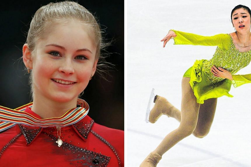 South Korea's reigning Olympic figure skating champion Kim Yu Na (right) brushed off the threat to her title from teenage Russian prodigy Julia Lipnitskaia as she left Seoul on Wednesday, Feb 12, 2014, for the 2014 Games. -- FILE PHOTO: REUTERS/AFP