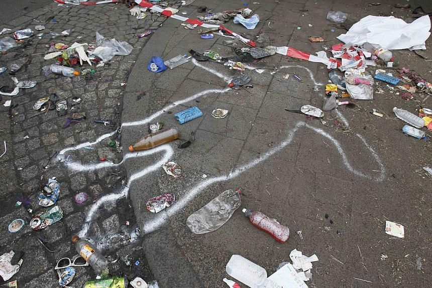 The position of a victim of a deadly stampede is marked on the street between two tunnels in Duisburg, on July 25, 2010. German prosecutors said on Wednesday, Feb 12, 2014, they had charged 10 people with negligent manslaughter and causing bodily har