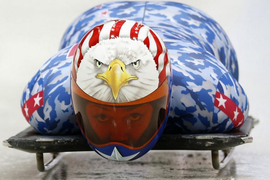 Katie Uhlaender of the US speeds down the track during a women's skeleton training session at the Sanki sliding centre in Rosa Khutor, a venue for the Sochi 2014 Winter Olympic, near Sochi, on Feb 8, 2014. Hurtling head first down the Sanki sliding c
