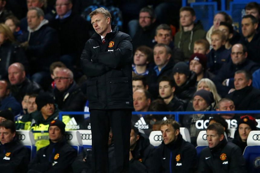 Manchester United manager David Moyes watches from the touchline during their English Premier League soccer match against Chelsea at Stamford Bridge in London, on Jan 19, 2014. Manchester United may be struggling to retain the Premier League title bu