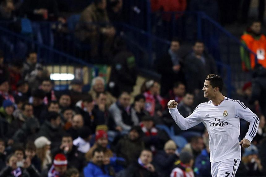 Real Madrid's Cristiano Ronaldo celebrates his goal against Atletico Madrid during their Spanish King's Cup semi-final second leg soccer match at Vicente Calderon stadium in Madrid on Feb 11, 2014. -- PHOTO: REUTERS