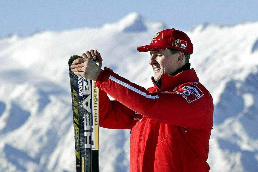 Picture taken on Jan 17, 2003, shows Formula one World champion Ferrari driver Michael Schumacher holding his skis before a giant slalom race in Madonna di Campiglio.Schumacher, who is still lying in a coma in a French hospital, has contracted