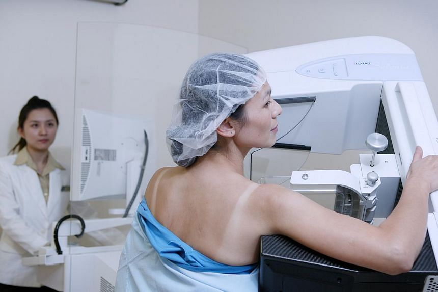 A patient undergoing mammogram to detect early stages of breast cancer. Going for the annual mammogram may not be entirely helpful, according to a new study. -- FILE PHOTO: CHANGI GENERAL HOSPITAL
