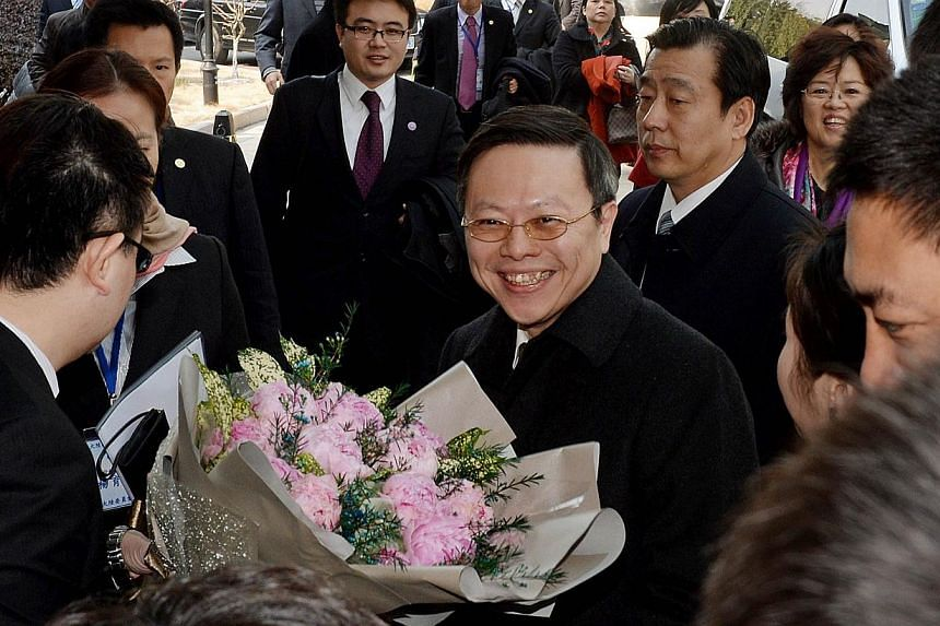 Taiwanese official Wang Yu-chi (centre), who is in charge of the island's China policy, arrives at the Purple Mountain Guest House on Feb 11, 2014. -- PHOTO: AFP