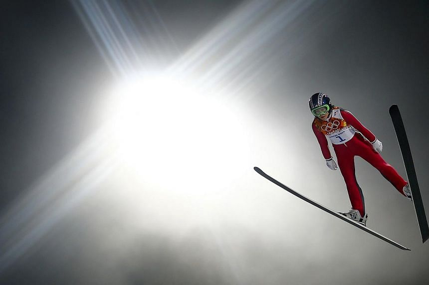 Sarah Hendrickson of the US soars through the air in her trial jump during the women's ski jumping individual normal hill event of the Sochi 2014 Winter Olympics, at the RusSki Gorki Ski Jumping Center in Rosa Khutor on Feb 11, 2014. -- PHOTO: REUTER