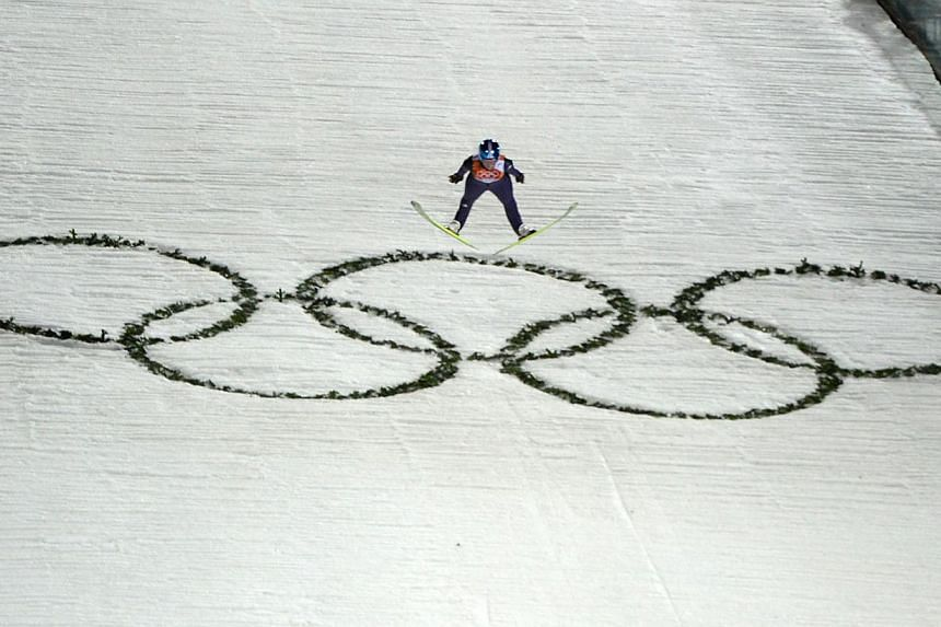Germany's Carina Vogt competes to win gold in the Women's Ski Jumping Normal Hill Individual Final Round at the RusSki Gorki Jumping Center during the Sochi Winter Olympics on Feb 11, 2014, in Rosa Khutor near Sochi . -- PHOTO: AFP