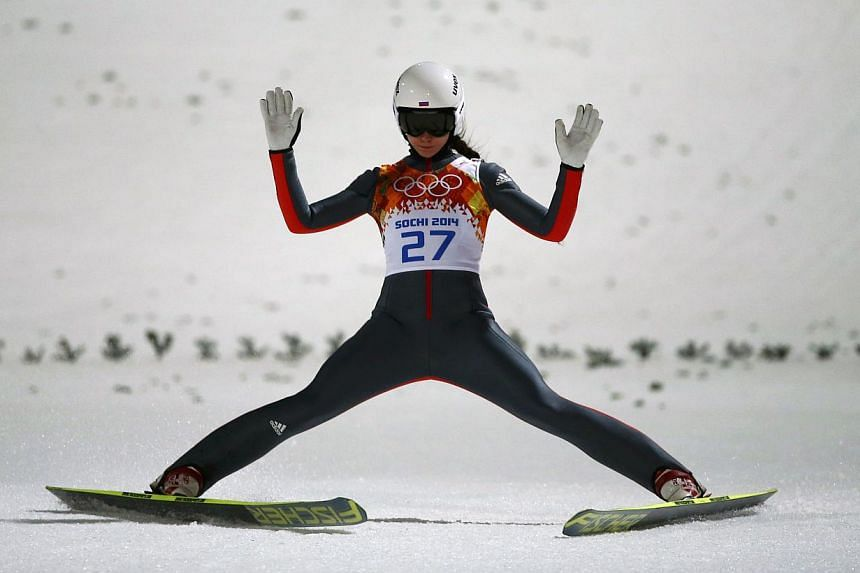 Russia's Irina Avvakumova reacts after her jump in the final round of the women's ski jumping individual normal hill event at the Sochi 2014 Winter Olympic Games, at the RusSki Gorki Jumping Centre, in Rosa Khutor on Feb 11, 2014. -- PHOTO: REUTERS