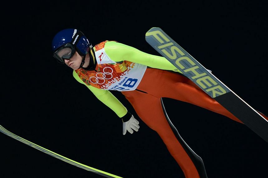 Austria's Daniela Iraschko-Stolz competes in the Women's Ski Jumping Normal Hill Individual trial at the RusSki Gorki Jumping Center during the Sochi Winter Olympics on Feb 11, 2014, in Rosa Khutor near Sochi . -- PHOTO: AFP