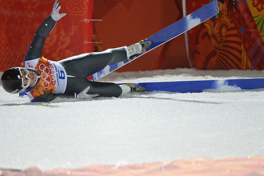 US Lindsey Van lies on the snow following her jump in the Women's Ski Jumping Normal Hill Individual Final Round at the RusSki Gorki Jumping Center during the Sochi Winter Olympics on Feb 11, 2014, in Rosa Khutor near Sochi . -- PHOTO: AFP