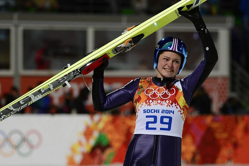 Germany's Carina Vogt celebrates winning gold in the Women's Ski Jumping Normal Hill Individual Final Round at the RusSki Gorki Jumping Center during the Sochi Winter Olympics on Feb 11, 2014. Carina Vogt made history on Tuesday, winning the first ev