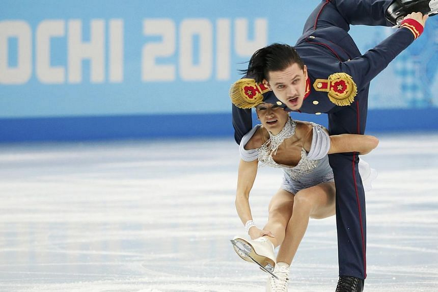 Russia's Tatiana Volosozhar and Maxim Trankov compete during the Figure Skating Pairs Short Program at the Sochi 2014 Winter Olympics, on Feb 11, 2014. Olympic team gold medallists Tatiana Volosozhar and Maxim Trankov are poised to restore Russia's p