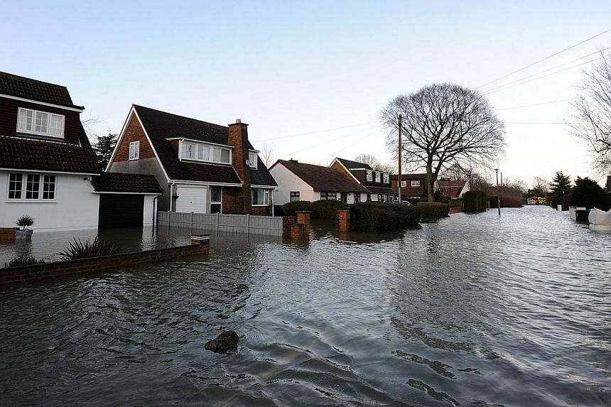 Floodwater surrounds properties in the village of Wraysbury, west of London, on Feb 12, 2014. -- PHOTO: AFP