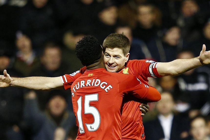 Liverpool's Daniel Sturridge (L) embraces team mate Steven Gerrard after scoring a goal against Fulham during their English Premier League soccer match at Craven Cottage in London February 12, 2014. -- PHOTO: REUTERS
