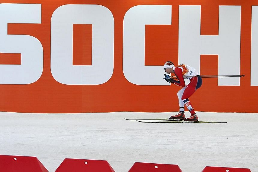 Norway's Magnus Krog skis during the cross country race of the Nordic Combined individual normal hill 10 km event of the Sochi 2014 Winter Olympics, at the RusSki Gorki Ski Jumping Center in Rosa Khutor on Thursday, Feb 12, 2014.The Internation