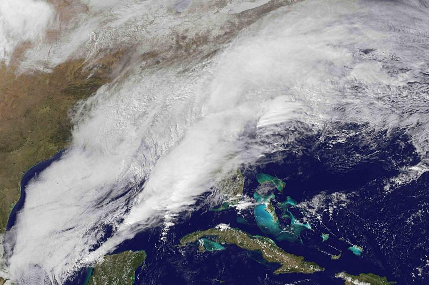The winter storm sweeping over the United States South and East Coast is seen in an image taken by NOAA's GOES-13 satellite on Feb 12, 2014, at 13:55 EST (2.55am Singapore time on Thursday). -- PHOTO: REUTERS