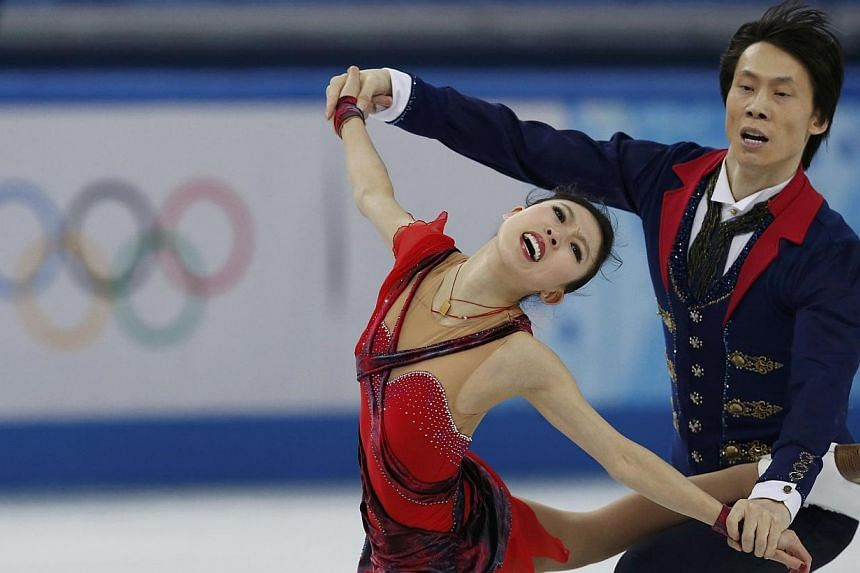 China's Pang Qing (left) and Tong Jian compete during the figure skating pairs free skating at the Sochi 2014 Winter Olympics, on Wednesday, Feb 12, 2014. Chinese veterans Pang Qing and Tong Jian, silver medallists at the 2010 Vancouver Olympics