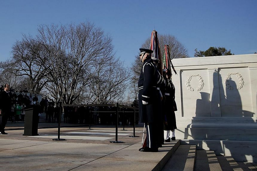 French President Francois Hollande, presents the Legion of Honour Medal to the World War II Unknown at Arlington National Cemetery in Arlington, Virginia, on Feb 11, 2014. Nearly 300 American veterans of the World War II D-Day landings plan to attend