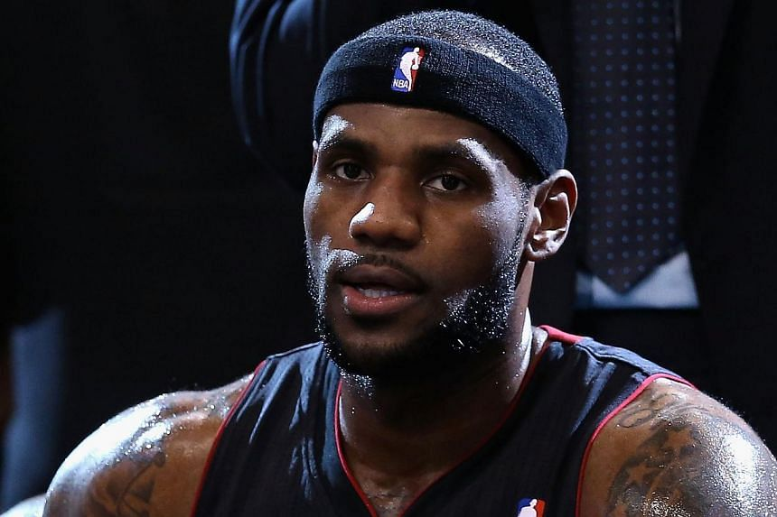 LeBron James #6 of the Miami Heat sits on the bench during a break from the NBA game against the Phoenix Suns at US Airways Center on Feb 11, 2014 in Phoenix, Arizona. -- PHOTO: AFP