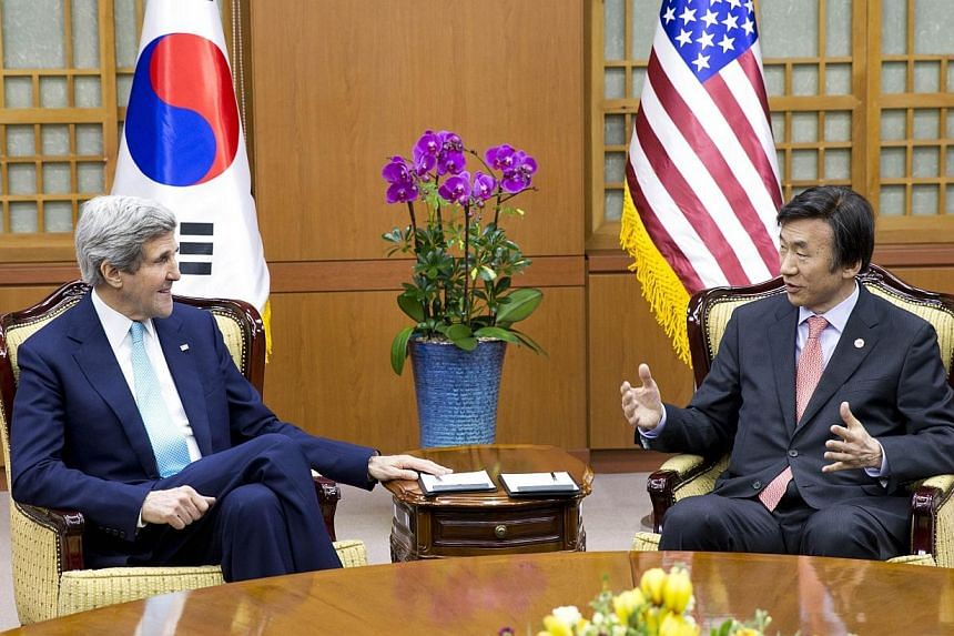 US Secretary of State John Kerry (left) speaks with South Korean Foreign Minister Yun Byung-se during their meeting in Seoul on Feb 13, 2014.Kerry said on Thursday, Feb 13, 2014, that military exercises with South Korea later this month will be