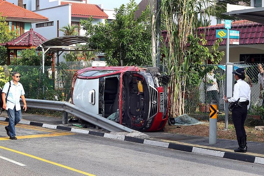 About 7.30am this morning, Feb 13, 2014, a taxi rammed into rail and landed on the pavement near the bus stop at Serangoon way towards the junction of Yio Chu Kang. -- ST PHOTO:LAU FOOK KONG