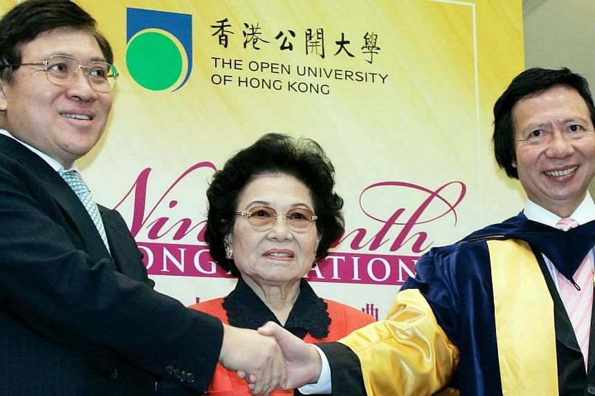 Billionaire brothers Raymond Kwok (left) and Thomas with their mother Kwong Siu-hing in 2010.Thomas and Raymond Kwok, the billionaire co-chairmen of Sun Hung Kai Properties Ltd, had additional charges filed against them on Thursday, in a briber