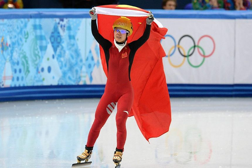 China's Li Jianrou celebrates after winning the gold medal in the Women's Short Track 500 m Final at the Iceberg Skating Palace during the 2014 Sochi Winter Olympics, on Feb 13, 2014. Li Jianrou of China won the women's 500 metres short track sp