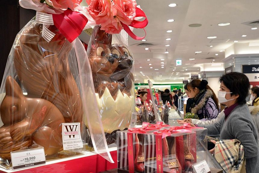 Female customers buy boxes of chocolates as gifts before Valentine's Day at Tokyo's Matsuzakaya department store, on Feb 13, 2014. Japanese women flocked to department stores on Thursday, Feb 13, 2014, to buy Valentine's Day chocolates for all the me