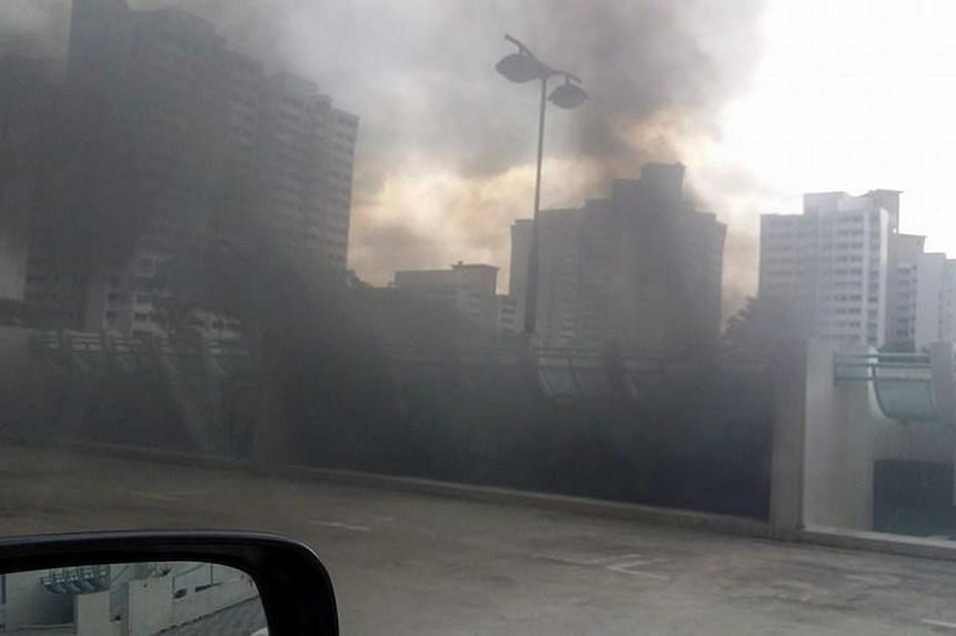Explosions heard at a multi-storey carpark at Toh Guan Road and subsequently carpark was engulfed by black smoke, on Feb 13, 2014.A fire broke out in a carpark along Toh Guan Road on Thursday evening, Feb 13, 2014, at about 5.30pm.-
